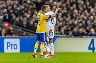 Juventus midfielder Miralem Pjanic and Tottenham Hotspur midfielder Dele Alli argue during the Champions League match between Tottenham Hotspur and Juventus FC at Wembley Stadium, London, England on 7 March 2018. Picture by Toyin Oshodi.