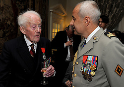 Veteran Humphrey Tottenham, 94, from Wiltshire talks to Colonel De Loustal from the French Parachute Regiment, after he received the Legion d'honneur, France's highest distinction, from the French Ambassador Sylvie Bermann for his role in liberating France during the Second World War, during a ceremony at the Ambassador's residence in Kensington, London.