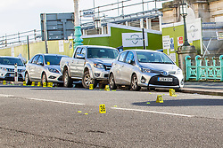 © Licensed to London News Pictures. 01/12/2019. Brighton, UK. Cars on Marine Parade are surrounded by Scene of Crime cones pointing out items off interest to the officers investigating after a mass fight ended in 3 people being hospitalised with serious injuries as they were hit by a car that was reported t be fleeing the scene.. Photo credit: Hugo Michiels/LNP