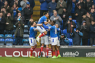 Portsmouth Defender, Matt Clarke (5) heads in a goal to make it 1-0 Portsmouth Players Celebrate during the EFL Sky Bet League 2 match between Portsmouth and Accrington Stanley at Fratton Park, Portsmouth, England on 11 February 2017. Photo by Adam Rivers.