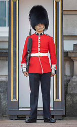 © Licensed to London News Pictures. 25/06/2020. London, UK. A member of The Coldstream Guards, on duty at Buckingham Palace, reacts to the extreme heat in the afternoon. High temperatures and sunshine are expected in most of the UK over the next few days. Photo credit: Peter Macdiarmid/LNP