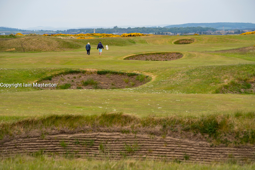 St Andrews, Scotland, UK. 21 May 2020. Scottish Government announces plan to ease covid-19 lockdown in Scotland. Starting at end of May non contact sports such as golf will be allowed. Members of the public make the most of access to famous Old Course at St Andrews during course closure during the lockdown.  Iain Masterton/Alamy Live News