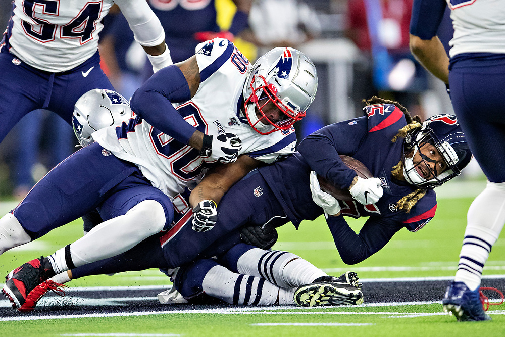 HOUSTON, TX - DECEMBER 1:  Will Fuller V #15 of the Houston Texans catches a pass during the first half and is tackled by Shilique Calhoun #90 of the New England Patriots at NRG Stadium on December 1, 2019 in Houston, Texas.  The Texans defeated the Patriots 28-22.  (Photo by Wesley Hitt/Getty Images) *** Local Caption *** Will Fuller V; Shilique Calhoun
