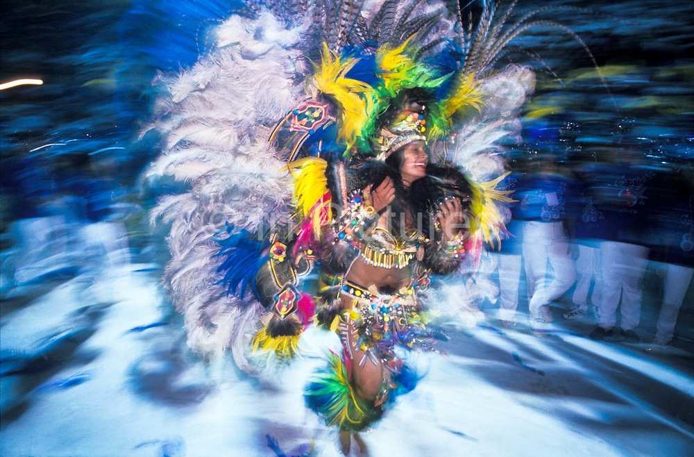 """The """"Cunha Poranga' Carnival Queen, dances inside the stadium during the three day event which celebrates the native Amazon indian myths and legends of the """" Boi Bumba"""" carnival, Parintins, Brazil"""