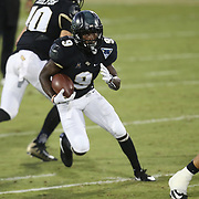 ORLANDO, FL - OCTOBER 14: Adrian Killins Jr. #9 of the UCF Knights runs the ball during a NCAA football game between the East Carolina Pirates and the UCF Knights at Spectrum Stadium on October 14, 2017 in Orlando, Florida. (Photo by Alex Menendez/Getty Images)