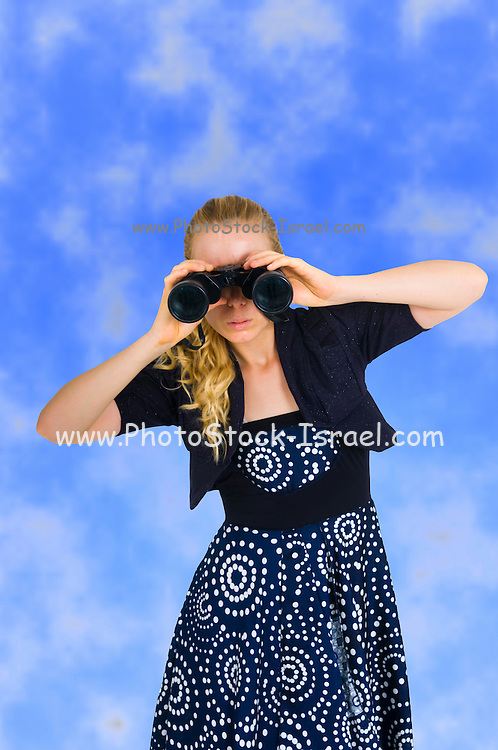 Young business woman looking at the future with binoculars On blue sky Background