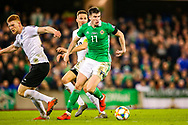 Northern Ireland midfielder Paddy McNair goes past Estonia defender Madis Vihmann during the UEFA European 2020 Qualifier match between Northern Ireland and Estonia at National Football Stadium, Windsor Park, Northern Ireland on 21 March 2019.