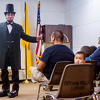 091913       Cable Hoover<br /> <br /> Actor Dave Ehlert portrays Abraham Lincoln during a performance at the Octavia Fellin Public Library in Gallup Thursday. Ehlert also played Mark Twain during the event.