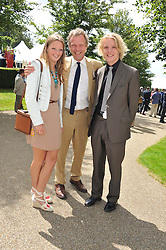 Centre, HUGO BURNAND with his children LILY and FERGUS at the 3rd day of the 2012 Glorious Goodwood racing festival at Goodwood Racecourse, West Sussex on 2nd August 2012.