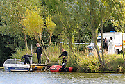 BEDFONT MIDDLESEX. Police and forensic officers inspect the blue and white speedboat and banana boat involved in the accident.  An 11-year-old girl has died after being seriously injured at a water sports centre in west London. The girl is thought to have been on an inflatable craft being towed by a boat when she was hurt at the Princes Club, Bedfont, near Feltham. Emergency services were called following the incident at about 1700 BST on Saturday and she was taken to West Middlesex Hospital but later died. A 22-year-old man has been arrested in connection with the incident.  13 September 2010. STEPHEN SIMPSON.