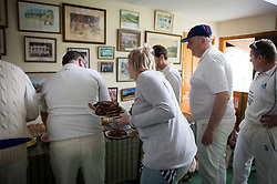 Embargoed to 0001 Monday August 28 Players come in for a tea break during the annual friendly match between Cravens Cavaliers and Lynton & Lynmouth Cricket Club at the ground based inside the Valley of Rocks, North Devon, on Saturday August 5th, 2017.