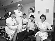 Tony Ward Gives Blood..1984.16.03.1984.03.16.1984.16th March 1984..With a possible shortage of blood over the St Patrick's Weekend,Tony Ward,Irish Rugby International,led an awareness campaign by donating blood. He attended The Blood Transfusion Service,Pelican House,Mespil Road,Dublin...Image shows Tony at the recovery point being well looked after by Nurses,(L-R),Barbara Maguire,Blackrock,Dublin. Ailbhe Kilfeather,Stillorgan,Dublin. Deirdre Hanon,Stillorgan,Dublin. Margarete Allen,Sutton,Dublin andAnne Nesbitt,Dublin.
