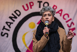 London, UK. 16th March, 2019. Nita Sanghera, Vice-President of the University and College Union (UCU), addresses thousands of people on the March Against Racism demonstration on UN Anti-Racism Day against a background of increasing far-right activism around the world and a terror attack yesterday on two mosques in New Zealand by a far-right extremist which left 49 people dead and another 48 injured.