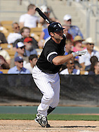 GLENDALE, AZ - MARCH 5:  Paul Konerko #14 of the Chicago White Sox singles against the Los Angeles Dodgers on March 5, 2010 at The Ballpark at Camelback Ranch in Glendale, Arizona. (Photo by Ron Vesely)