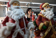 Workers make petroleum resin based gift items and garden ornaments at the Chuan Sen Art & Design Factory on the outskirts of Guangzhou, in Guangdong Province, China on 04 February, 2009.  Orders at the factory, who sells almost all of their wares in North America and Europe, has declined drastically in the last two years.Workers make petroleum resin based gift items and garden ornaments at the Chuan Sen Art & Design Factory on the outskirts of Guangzhou, in Guangdong Province, China on 04 February, 2009.  Orders at the factory, who exports almost all of their wares in North America and Europe, has declined drastically in the last two years due to the economic slowdown and western consumers' belt-tightening.Workers make petroleum resin based gift items and garden ornaments at the Chuan Sen Art & Design Factory on the outskirts of Guangzhou, in Guangdong Province, China on 04 February, 2009.  Orders at the factory, who exports almost all of their wares in North America and Europe, has declined drastically in the last two years due to the economic slowdown and western consumers' belt-tightening.