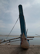 Sri Lanka, Ampara District, Arugam Bay, Pottuvil a small fishing village and popular surfing resort. Traditional fishing boat on the shore