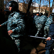 Members of Russia's OMON (Special Force) beat a crowd of peaceful protesters in Moscow. .Police detained Garry Kasparov, the former world chess champion who now leads one of Russia's strongest opposition movements, and 170 other activists as they gathered for a forbidden anti-Kremlin demonstration in central Moscow..The demonstration, one in a series of so-called Dissenters' Marches, increased tension between opposition supporters who complain the Kremlin is cracking down on political dissent and authorities who vow to block any unauthorized demonstrations.