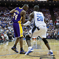 09 June 2009: Kobe Bryant of the Los Angeles Lakers dribbles against Mickael Pietrus of the Orlando Magic during game 3 of the 2009 NBA Finals won 108-104 by the Orlando Magic over the Los Angeles Lakers at Amway Arena, in Orlando, Florida, USA.