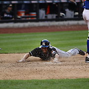 Placido Polanco, Miami Marlins, slides into home plate to score the winning run during the New York Mets V Miami Marlins, Major League Baseball game which went for 20 innings and lasted 6 hours and 25 minutes. The Marlins won the match 2-1. Citi Field, Queens, New York. 8th June 2013. Photo Tim Clayton