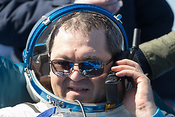 Expedition 62 cosmonaut Oleg Skripochka is seen talking to family via satellite phone outside the Soyuz MS-15 spacecraft after he landed with NASA astronauts Andrew Morgan and Jessica Meir in a remote area near the town of Zhezkazgan, Kazakhstan on Friday, April 17, 2020. Meir and Skripochka returned after 205 days in space, and Morgan after 272 days in space. All three served as Expedition 60-61-62 crew members onboard the International Space Station.<br /> <br /> Where: Zhezkazgan, Kazakhstan<br /> When: 17 Apr 2020<br /> Credit: NASA/GCTC/Andrey Shelepin/Cover Images<br /> <br /> **Editorial use only**