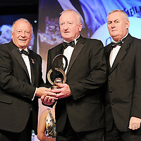 """13 November 2010; Johnny Hayes, Clare, is presented with the Hall of Fame Award by Pat Quill, left, President, Cumann Peil Gael na mBan, and Uachtar·n CLG CriostÛir """" Cuana, at the O'Neills TG4 Ladies Football All-Star Awards 2010, Citywest Hotel, Saggart, Co. Dublin. Picture credit: Brendan Moran / SPORTSFILE *** NO REPRODUCTION FEE ***"""