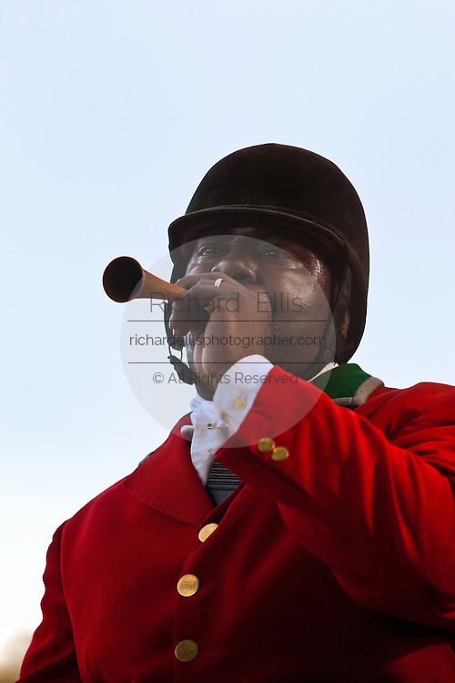 Jamie Greene, master of the hounds at the Middleton Place Fox Hunt, calls the hounds using a hunting horn during the weekly fox hunt at Middleton Place plantation in Charleston, SC.