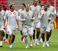 Photo: Chris Ratcliffe.<br />England Training Session. FIFA World Cup 2006. 19/06/2006.<br />David Beckham, Wayne Rooney, Aaron Lennon in training.