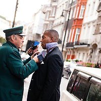 London, UK - 19 September 2012: security guards get prepared in front of the Mark's Club before the fundraising dinner in London for President Barack Obama's 2012 re-election bid.
