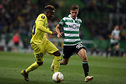 February 14, 2019 - Lisbon, Portugal - Villarreal's forward Samuel Chukwueze (L) vies with Sporting's midfielder Miguel Luis from Portugal during the UEFA Europa League Round of 32 First Leg football match Sporting CP vs Villarreal CF at Alvalade stadium in Lisbon, Portugal on February 14, 2019. (Credit Image: © Pedro Fiuza/ZUMA Wire)