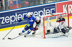 Anze Kopitar of Slovenia vs Dylan Larkin of USA and Connor Hellebuyck of USA during Ice Hockey match between Slovenia and USA at Day 10 in Group B of 2015 IIHF World Championship, on May 10, 2015 in CEZ Arena, Ostrava, Czech Republic. Photo by Vid Ponikvar / Sportida