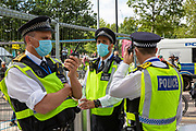 Police keep a close eye on Extinction Rebellion 'Shell Out' protest on 8th September 2020 in London, United Kingdom. The environmental group gathered outside the Shell building to protest at the ongoing extraction of fossil fuels and the resulting environmental record. Extinction Rebellion is a climate change group started in 2018 and has gained a huge following of people committed to peaceful protests. These protests are highlighting that the government is not doing enough to avoid catastrophic climate change and to demand the government take radical action to save the planet. (photo by Andrew Aitchison / In Pictures via Getty Images)