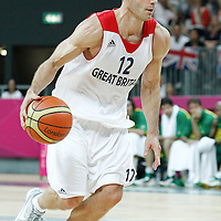 31 July 2012: Great Britain Nate Reinking dribbles during 67-62 Team Brazil victory over Team Great Britain, during the men's basketball preliminary, at the Basketball Arena, in London, Great Britain.
