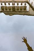 Reflection on water of a reaching hand in Comares courtyard in la Alhambra (Granada).<br /> Una mano se refeleja junto a la arquitectura en el estanque del Patio de Comares, en la Alhambra.
