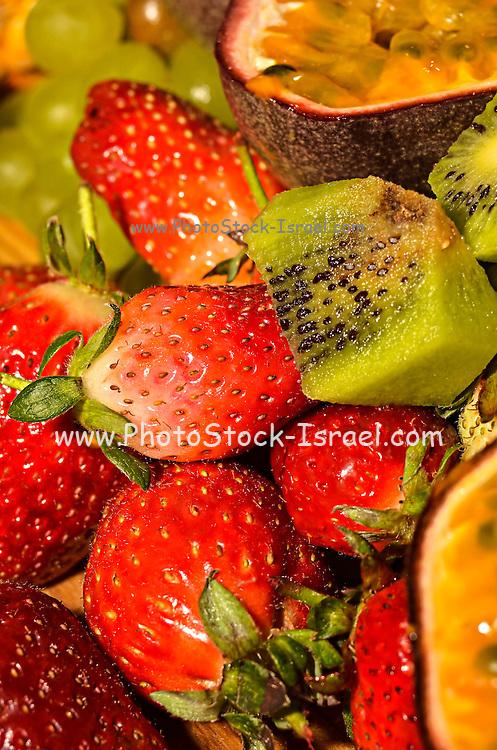 Fresh fruit salad with strawberries, Kiwi and passion fruit