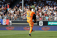 Benoit Costil (Girondins de Bordeaux) catched the ball behind Baptiste GUILLAUME (SCO Angers) during the French championship L1 football match between SCO Angers and Bordeaux on August 6th, 2017 at Raymond-Kopa stadium, France - PHOTO Stéphane Allaman / ProSportsImages / DPPI