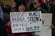 A woman holds a signs saying Diversity Makes America Strong at a  protest march and rally organised by the Alliance for an Inclusive America group against the perceived anti-Muslim and anti-foreigner immigration policies of President Donald Trump, Shibuya, Tokyo, Japan. Sunday February 12th 2017. The Alliance of an Inclusive America is a multi-faith non-partisan group. About 250 Americans, other ex-pats and japanese people took part in the march to show people around the world they reject the Executive Order President Trump enacted at the end of January, indefinitely suspending the resettlement of Syrian refugees and temporarily banning people from seven majority Muslim countries from entering the United States.
