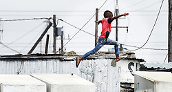 SOUTH AFRICA - Cape Town - 12 October 2020- Kids playing on Top of toilets in BM Informal Settlement that is along the N2 in Khayelitsha.Some are busy jumping from one toilet to the next,as they are not in school because of Covid regulations  .Photograph; Phando Jikelo/African News Agency(ANA)