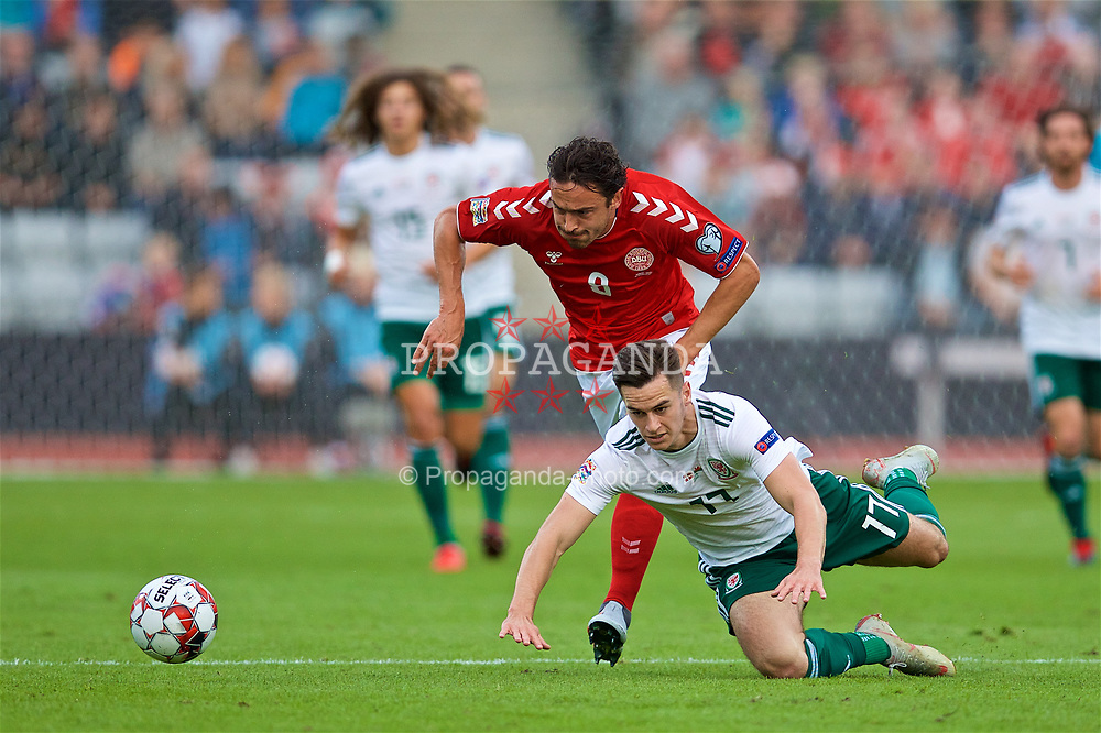 AARHUS, DENMARK - Sunday, September 9, 2018: Wales' Tom Lawrence (right) and Denmark's Thomas Delaney (left) during the UEFA Nations League Group Stage League B Group 4 match between Denmark and Wales at the Aarhus Stadion. (Pic by David Rawcliffe/Propaganda)