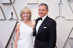 Bob Iger and Willow Bay arrive on the red carpet of The 91st Oscars® at the Dolby® Theatre in Hollywood, CA on Sunday, February 24, 2019.