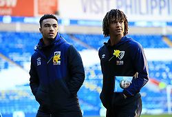 Bournemouth's Junior Stanislas (left) and Bournemouth's Nathan Ake ahead of the match during the Premier League match at the Cardiff City Stadium.