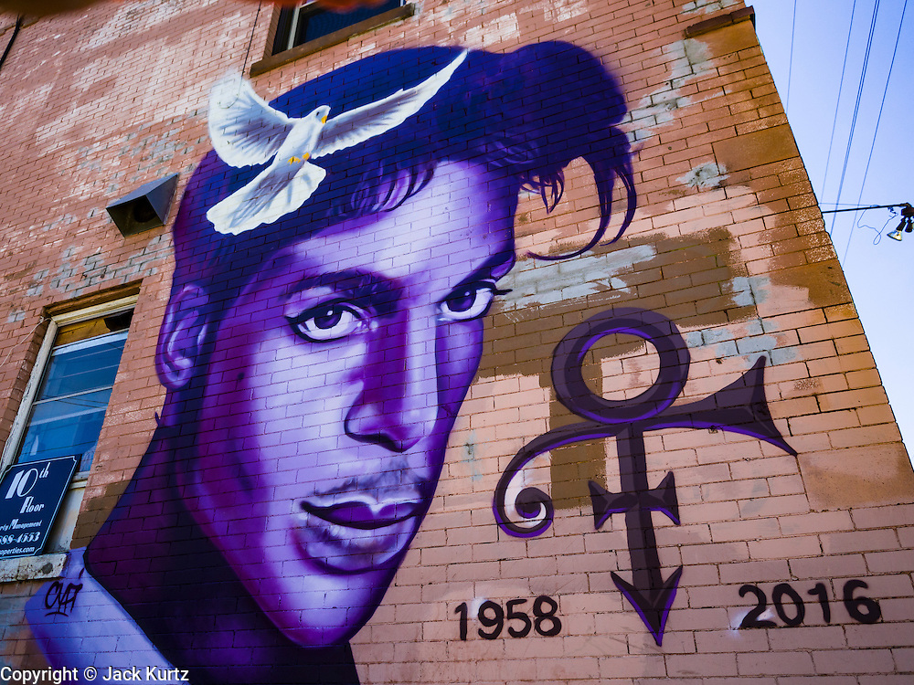 """29 APRIL 2016 - MINNEAPOLIS, MINNESOTA:  Minneapolis artist Rock """"Cyfi"""" Martinez painted this mural of Prince on a building at 26th Street and Hennepin Ave in Minneapolis. Music icon and legend Prince was from Minneapolis and his commercial empire was based in the Minneapolis suburb of Chanhassen.      PHOTO BY JACK KURTZ"""