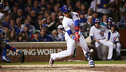 October 18, 2017 - Chicago, IL, USA - The Chicago Cubs' Javier Baez hits a solo home run in the fifth inning, his second of the game, against the Los Angeles Dodgers during Game 4 of the National League Championship Series at Wrigley Field in Chicago on Wednesday, Oct. 18, 2017. (Credit Image: © Nuccio Dinuzzo/TNS via ZUMA Wire)