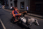 Travelers ride their miniature carts and poneys into Appleby. Romany Gypsies at Appleby Fair, Cumbria. The most important annual Gypsy horse fair whre Romany Gypsies and travelers meet to trade their wares...English Romany Gypsies traditionally traveled the country roads camping nearby towns and villages, choosing the grassy roadside banks, where they tethered their horses, or in farmer's fields, when they were allowed. Travelling in bowtop wagons drawn by horses, and before that with tents, sometimes with horse drawn carts or just by foot. Often they worked as casual agricultural labourers, doing the seasons work. They also could earn their living in different ways, sometimes selling their wares, brass, tin, wood and cloth, such as embroidered cloths or lace, telling fortunes, music and dancing, and through crafts skills in basket making, plaiting chair bases, sharpening knives,  They would make fires from old wood, cleaning up after them when they moved on. There were several horse fairs, notably Appleby in Cumbria and Stow-on-Wold in the Cotswolds where they trade and sell horses, some traditions which keep to this day.