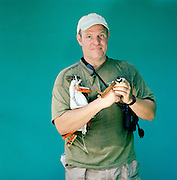 Portrait of a wildlife conservationist holding birds at the Tortuguero National Park, East Coast, Tortuguera, Limon, Costa Rica