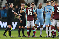 Mark Noble, the West Ham United captain argues with Referee Kevin Friend after full time. Premier league match, West Ham Utd v Manchester city at the London Stadium, Queen Elizabeth Olympic Park in London on Wednesday 1st February 2017.<br /> pic by John Patrick Fletcher, Andrew Orchard sports photography.
