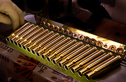HERSTAL, BELGIUM - JUNE-13-2003 - Shell casings are cleaned and polished by special machines and then inspected by hand before being loaded with live rounds at the FN Herstal weapons fabrication plant near Liege, Belgium. (PHOTO © JOCK FISTICK)