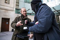 © Licensed to London News Pictures. 11/02/2018. London, UK. UKIP Leader Henry Bolton signs an autograph outside BBC Broadcasting House. Photo credit: Rob Pinney/LNP