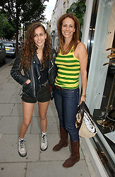 Left to right, ALICE DELLAL and her mother ANDREA DELLAL at an exhibition of rock photographer Mick Rock's exclusive 'the One and Only' photographic prints held at Notting Hill's newly opened boutique 'One' 30 Ledbury Street, London W11 on 22nd June 2006.<br /><br />NON EXCLUSIVE - WORLD RIGHTS