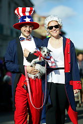 31 January 2016. New Orleans, Louisiana.<br /> Mardi Gras Dog Parade. Andy Wilcox and Abby Crick with dog Smoggy. The Mystic Krewe of Barkus winds its way around the French Quarter with dogs and their owners dressed up for this year's theme, 'From the Doghouse to the Whitehouse.' <br /> Photo©; Charlie Varley/varleypix.com
