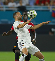 July 31, 2018 - Miami Gardens, FL, USA - Real Madrid forward Borja Mayoral (21) challenges for the ball with Manchester United defender Eric Bailly during the second half during International Champions Cup action at Hard Rock Stadium in Miami Gardens, Fla., on Tuesday, July 31, 2018. Manchester United won, 2-1. (Credit Image: © David Santiago/TNS via ZUMA Wire)
